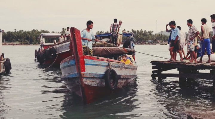men in a boat in mainland southeast asia