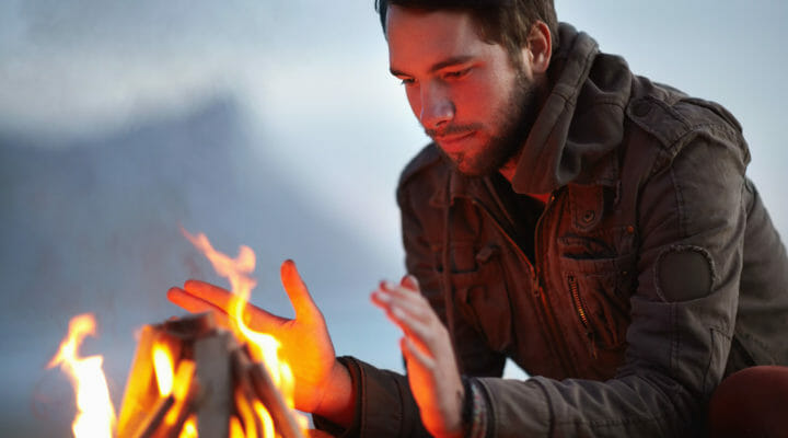 around-the-campfire-man-hands