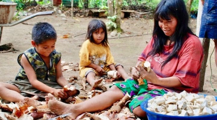 Family preparing Yucca in Ecuador