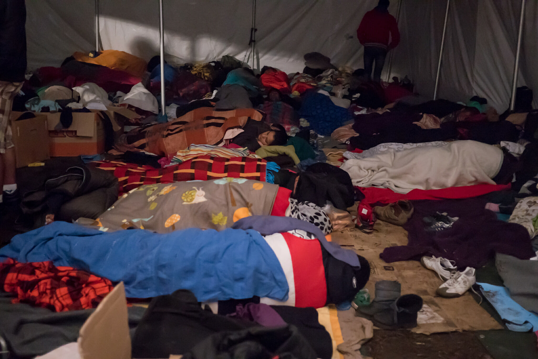Refugees get some rest in transit through Budapest