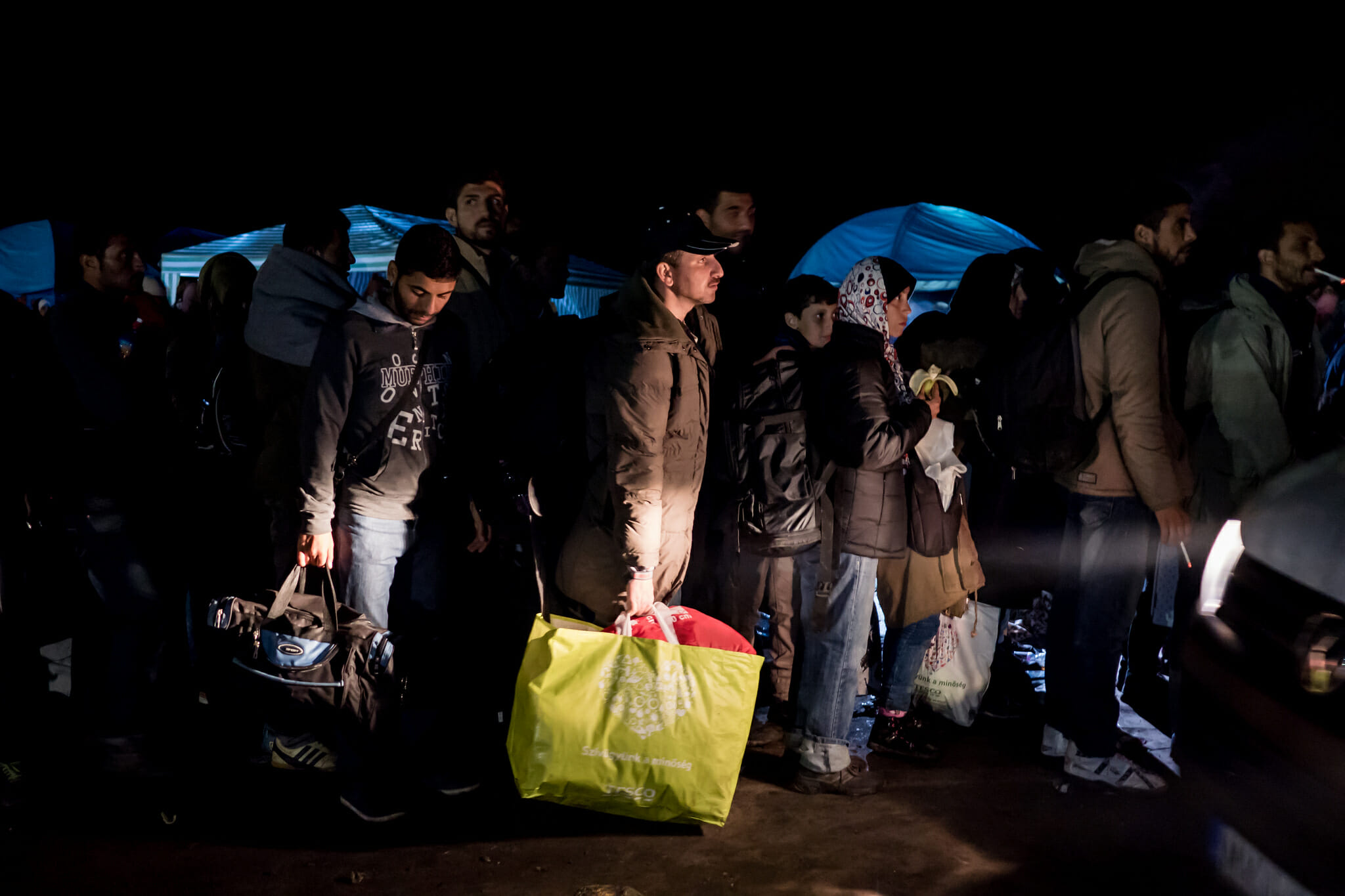 refugees wait in line