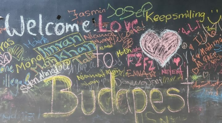 wall of messages to and from rufugees in Budapest