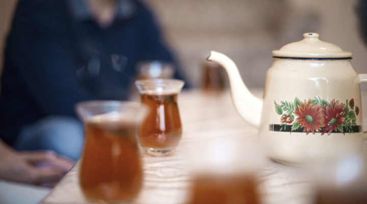 A missionary shares tea in the context of her immigrant ministry.