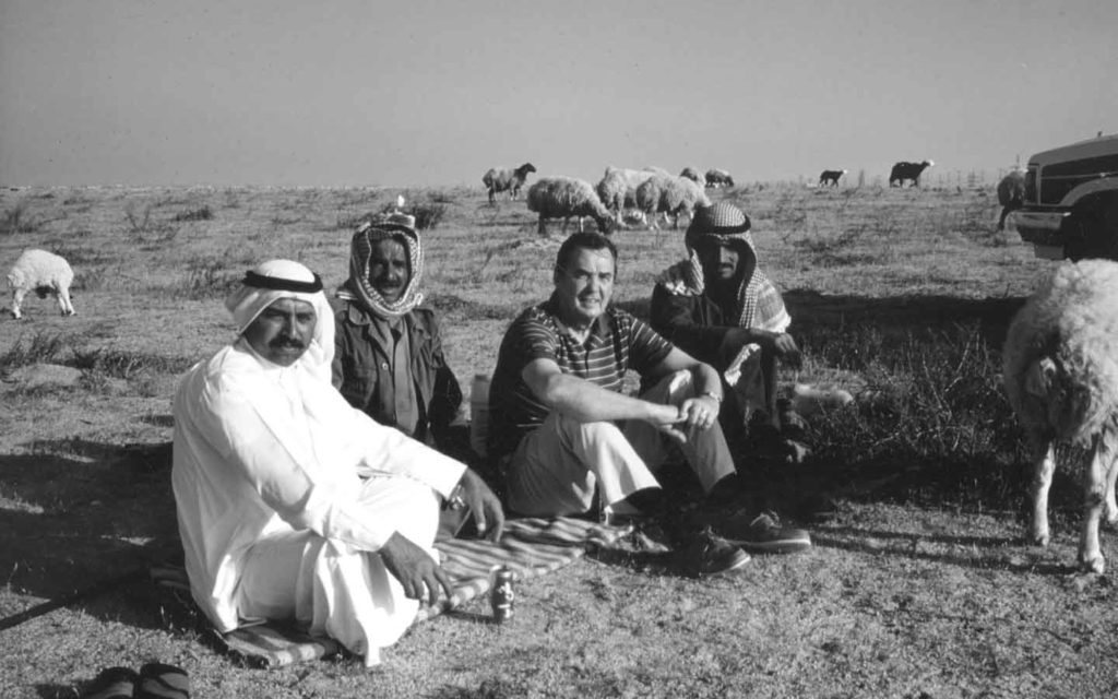 Ted Fletcher with Bedouin shepherds in Kuwait after the Gulf War.