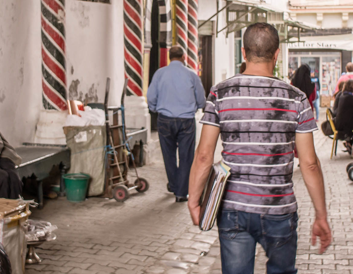 north-africa-global-youth-culture-man-walking-with-books