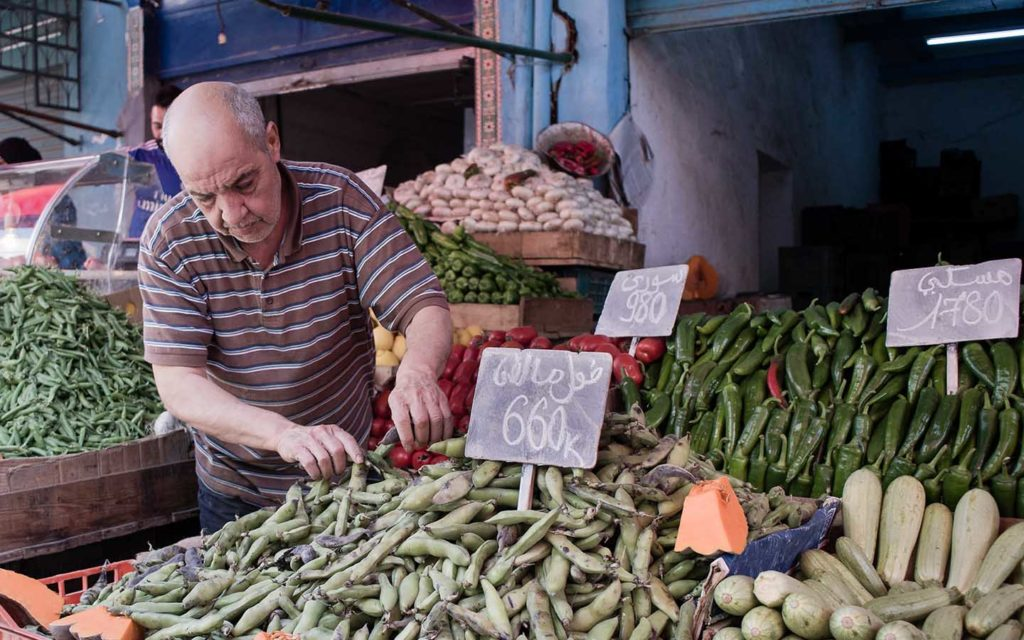man sells vegetables in the market