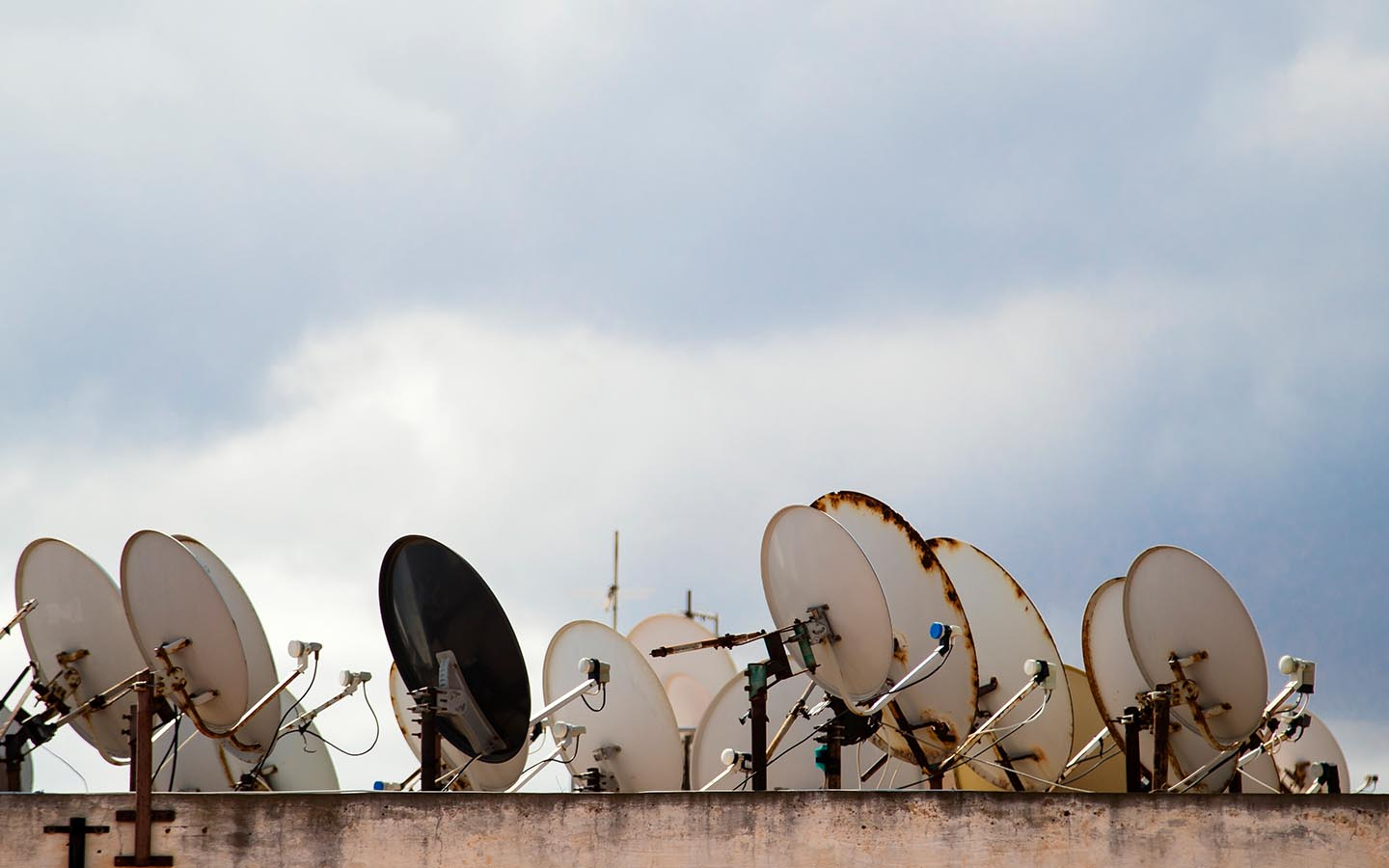photo of a rooftop full of satelite dishes