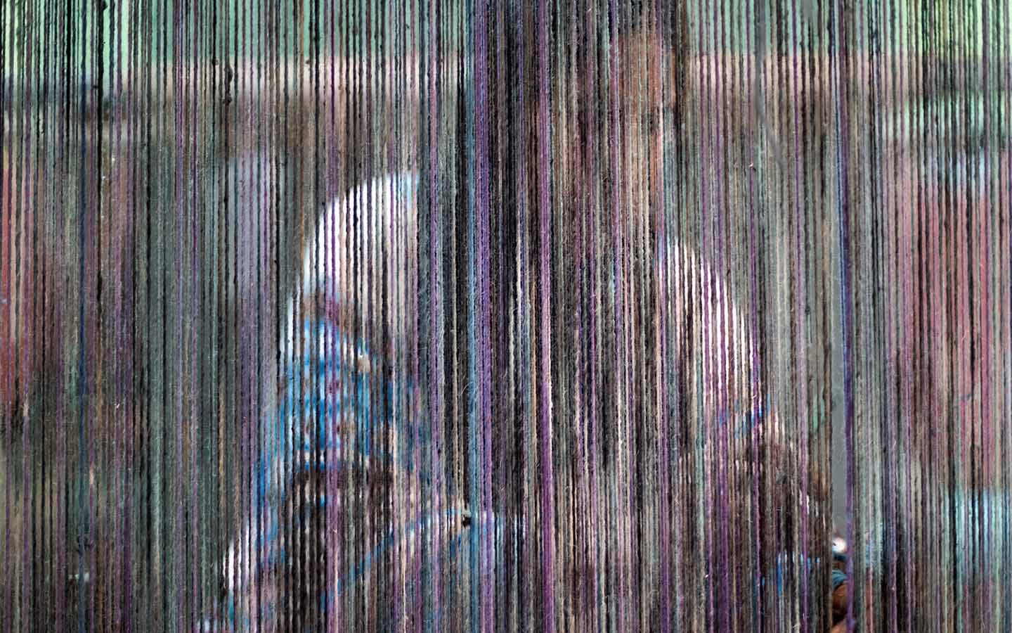 photo of woman behind her weaving in North Africa