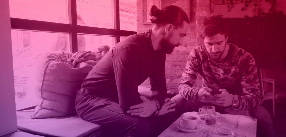 Digital media outreach - men looking at smart phone