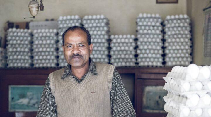 Building bridges through business - South Asian man standing in egg shop