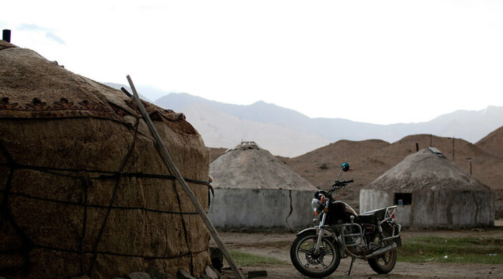 Mission motivations - a motorcycle sits outside a hut in a remote village